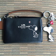 """Coach & Snoopy Wristlet & Keychain NWT~Size 6"""" X 4 Coach & Snoopy Wristlet & Keychain NWT~Size 6"""" X 4""""~Firm unless Bundled~It's hard to take a picture without a glare from the leather.  There are NO IMPERFECTIONS with the Wristlet or Keychain.  Haters WILL BE BLOCKED. Coach Bags Clutches & Wristlets"""