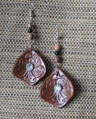 Leather flower earrings by JuliciasCreations on Etsy, $8.00