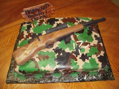 Rifle & Camo Cake 1/4 Sheet rum cake with buttercream and MMF, hand made rifle with rice crispy and fondand, I am very please how this...