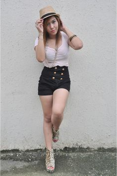 Like the idea, looks a little ghetto on her though. I dont like those shoes, but I love the shorts and hat combo.
