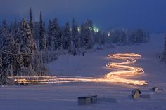 Folks going down with torches at Iso-Syöte skiing centre, Finland