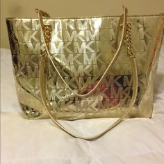 Gold Michael Kors Patent Leather Tote *Authentic* This Michael Kors bag is about a year and a half old and rarely ever been used. The bottom and inside look great and it's patent leather material has not yet been torn, frayed, or scratched. In great condition. Michael Kors Bags Totes