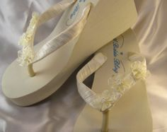 Items similar to Ivory Flip Flops or White Flip Flops with Pearls and Rhinestones Beach Wedding Sandals Ivory Bridal Sandals Ivory Wedding Sandals on Etsy Beach Wedding Sandals, Bridal Sandals, Ivory Sandals, Wedding Beach, Wedding Slippers, White Flip Flops, Flip Flop Sandals, Beaded Bracelets, Beautiful