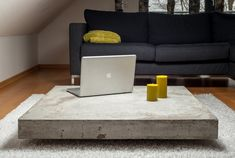 flat and floating - our modern lounge table gives any living room a unique minimalist look lounge+ is our concrete coffee table with 10 cm thick concrete table top and a 5cm high base from MDF.