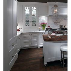If we do white cabinets and white countertops, loving the dark floors Plain & Fancy Custom Cabinetry Romantic Kitchen Cabinetry
