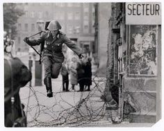 pinner writes: East German soldier jumping barbed wire barricade to freedom as he defects from East Berlin, 1961. Photo: Associated Press