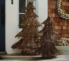 DIY Lit Twig Trees I could do this using different size wire lamp shades and hot glue twigs all around..Nice idea #potterybarn