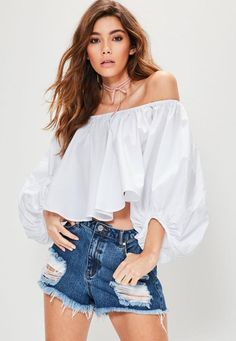 Bardot is the neckline of the season, we're lusting over this white crop top - featuring balloon sleeves, a bardot neckline and cropped length. This is at the top of our lust have list!