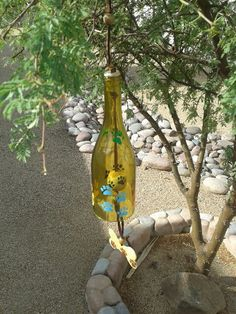 Wine bottle wind chime made for dog lovers. Unique gift for any dog owner. Beautiful yard or garden art. Dog memorial or pet sympathy gift. by WaggyPawChimes on Etsy Dog Memorial, Unique Gifts, Handmade Gifts, Sympathy Gifts, Bottle Crafts, Dog Owners, Garden Art, Wind Chimes, Upcycle