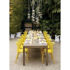 outdoor furniture....love the yellow chairs and the hanging outdoor chandelier.