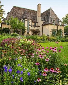 A wave of various coneflowers creates movement by drawing attention to the repeated colors and shapes in this Ohio garden. See more summer flower favorites from this gardener: http://www.midwestliving.com/garden/featured-gardens/garden-tour-three-part-harmony/?page=8
