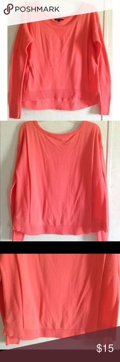 American Eagle Mixed Knit Coral Sweater There are quite a few snags and runs on the sleeves and sides. Some of the snags have caused holes especially a couple on a sleeve. Some wash wear on the front. Super cute American Eagle pullover sweater. Bright coral pink color. Solid knit front with V detail at the neck. Looser knit sides and sleeves. High low style, slightly longer in the back. Size medium. American Eagle Outfitters Sweaters Crew & Scoop Necks