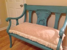 Aqua Painted bench. Homemade wreath applique.I made the mold from silicone caulking. Water putty was poured into the mold.
