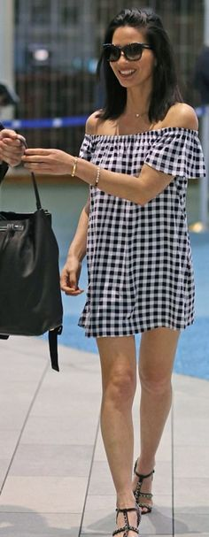 Who made Olivia Munn's black chain sandals, gingham off the shoulder dress, and black backpack?
