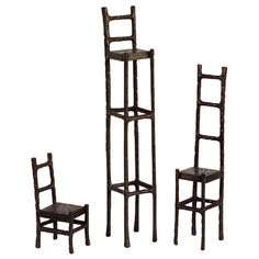 Whimsically delightful, this set of iron chair statuettes features exaggerated proportions for a touch of playful imagination.      Pro...