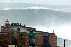 Brazilian surfer Carlos Burle rides a huge wave, near Nazare on Portugal's Atlantic coast CREDIT: AP