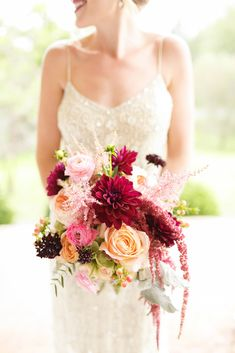 A wine-colored dahlia was the star of this warm garden rose, ranunculus, berry, astilbe, and amaranthus arrangement, by George's Flowers.