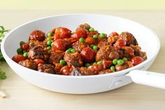 Whole cherry tomatoes make for sweet bursts of juiciness alongside spicy lamb meatballs.