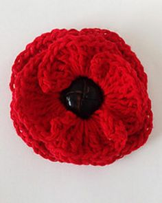 This flower can be worked with any weight of yarn. Finer weights will create a smaller flower, and bulkier weights will create a larger flower. Use the hook size appropriate for the yarn you choose. We used worsted weight yarn and a size H-8 hook in our samples. You'll also need a black or dark brown button approximately one inch in diameter.