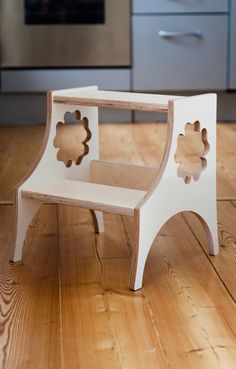 Wooden kids step stool. Birch plywood stool with five leaf clover ornament handles.
