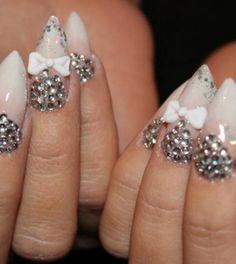 Stiletto nails. Love the shape of the rhinestones
