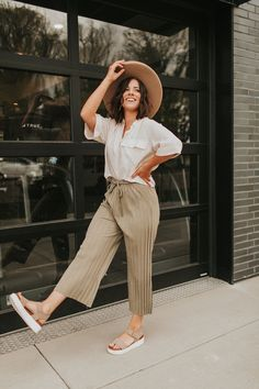 The material of this pant is stretchy which makes it so comfy! We love how it can be styled with other neutral colors or you can style it with brighter colors as well! Don't forget the brimmed hat and platform sandals!