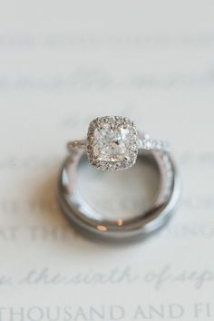 We're in love with this cushion cut halo engagement ring    Photography: Candice Adelle - http://candiceadelle.com/