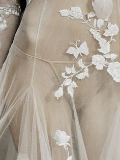 Sheer dress with floral embroidery; sewing; close up fashion detail // Alexander McQueen Spring 2007