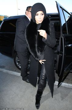 All covered up: Kim Kardashian was spotted bundled up in an all-black winter outfit on Wednesday as she headed to a flight out of Los Angeles to join her family in Paris