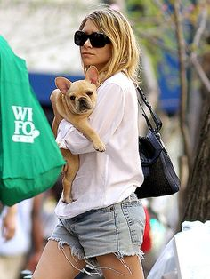 Ashley Olsen has been spotted around with her adorable Frenchie. He's the perfect accessory for her fabulous style!