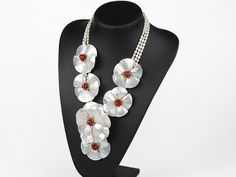 White Freshwater Pearl and Carnelian and White Lip Shell Flower Party Necklace: http://www.aypearl.com/wholesale-shell-jewelry/wholesale-jewellery-X2914.html