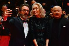 """(L-R) Members of the jury, Icelandic artist Olafur Eliasson, Tunisian producer Dora Bouchoucha Fourati and Chinese director Wang Quanan pose as they arrive for the opening of the Berlinale film festival with the premiere of """"Django"""" during the 67th Berlinale film festival in Berlin on February 9, 2017. / AFP / John MACDOUGALL"""