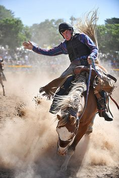 Rodeo at Taralga Lord help us! A helmet on a bronc rider!
