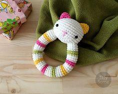 View Rattles by TillySome on Etsy Crochet Kids Scarf, Crochet Lovey, Gato Crochet, Crochet Dinosaur, Happy Cow, Lovey Blanket, Baby Rattle, Yarn Needle, Stitch Markers