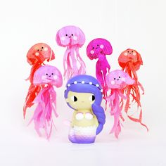 Sunshine Momiji dolls. Momiji are hand painted resin message dolls. Turn them upside down…inside every one there's a tiny folded card for your own secret message. #momijihq #momiji #dolls #momijidolls #cute #gift #sweet #mermaid #jellyfish #pink #colour