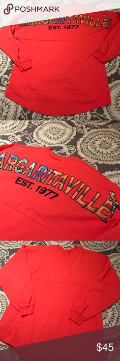 Margariteville spirit jersey 💟 worn once. got because i got cold on vacation. size small but runs big so will easily fit a medium. super cute parrot on the shoulder. mint condition ! Margaritaville Tops Tees - Long Sleeve