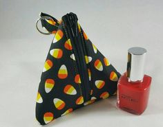 Check out this item in my Etsy shop https://www.etsy.com/listing/463871186/candy-corn-triangle-polish