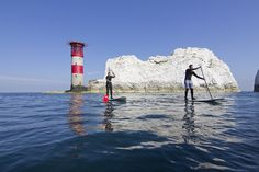 Grab a paddle board and head out across The Needles on the Isle of Wight! #redfunnel #isleofwight