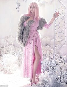 Leggy: The starlet get leggy in a baby pink broderie anglaise button-up gown paired with a fur stole