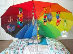 How do you turn an umbrella into a sensory experience? Simple - have lots of Under the Umbrella Sensory Play fun with your babies and toddlers! Infant Sensory Activities, Toddler Learning Activities, Sensory Toys, Craft Activities, Children Activities, Montessori Baby, Baby Play, Cool Baby Stuff, Cool Toys