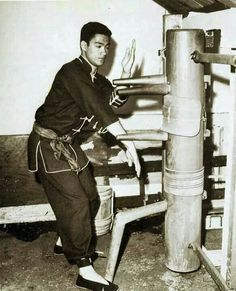 Bruce Lee, Wing Chun dummy practice. We all started somewhere. :)
