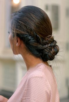 Fishtail braid side bun updo that's slightly messy for a more undone hairstyle. Would be pretty for bride or bridesmaid hair too!