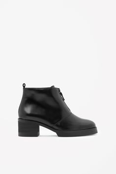 These ankle boots are made from smooth polished leather and have a modern zip fastening along the front. With a chunky rubber and wood stacked sole, they have a lightly cushioned leather insole and raw-cut pull tab on the ankle.