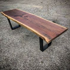 Live edge black walnut coffee table by barnboardstore.com - this was a very nice single slab we finished with a satin clear coat and black trapezoid steel legs.