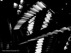 Milano distinguishing marks in black and white photos. Stairs of Libreria Feltrinelli Piazza Duomo.