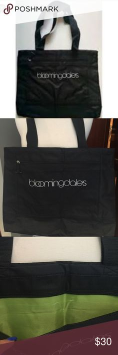 "BLOOMINGDALES SHOULDER CANVAS TOTE BAG BLOOMINGDALES Black shoulder shopping tote  bag with zippers and pockets.  Very unique.  It has 2 zipper closures for top and one outside the bag. Black straps.  AUTHENTIC.  BRAND NEW.  A PERFECT CARRY ON.    MEASURES.  17""Length 14""Height 5"" depth.  strap drop 12"" Bloomingdale's Bags Totes"