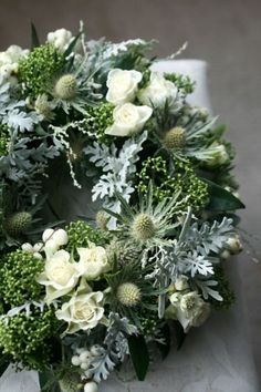 A beautiful white, silver grey but predominately green wreath. Perfect for a wed… A beautiful white, silver grey but predominately green wreath. Perfect for a wedding or event where the colour blend is the simplicity of white and green. Funeral Arrangements, Christmas Arrangements, Flower Arrangements, Christmas Door Wreaths, Christmas Flowers, Christmas Decorations, Deco Floral, Arte Floral, Funeral Flowers
