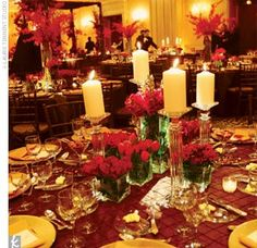 Pillar and votive candles surrounded the centerpieces, and guests found turtle chocolate favors at their place settings. The stunning red flowers, along with votive and pillar candles, mahogany chairs, and chocolate brown linens with gold accents, made fo...