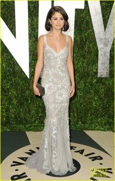Dolce&Gabbana dress, Stuart Weitzman shoes and a Judith Leiber clutch.