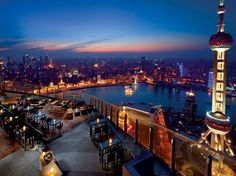 """9. Ritz–Carlton Shanghai, Pudong. """"It's the sort of place you dream of staying in."""" The Pudong hotel fills the top floors of a 58-story financial district building that's a quick walk from the iconic Oriental Pearl Tower."""